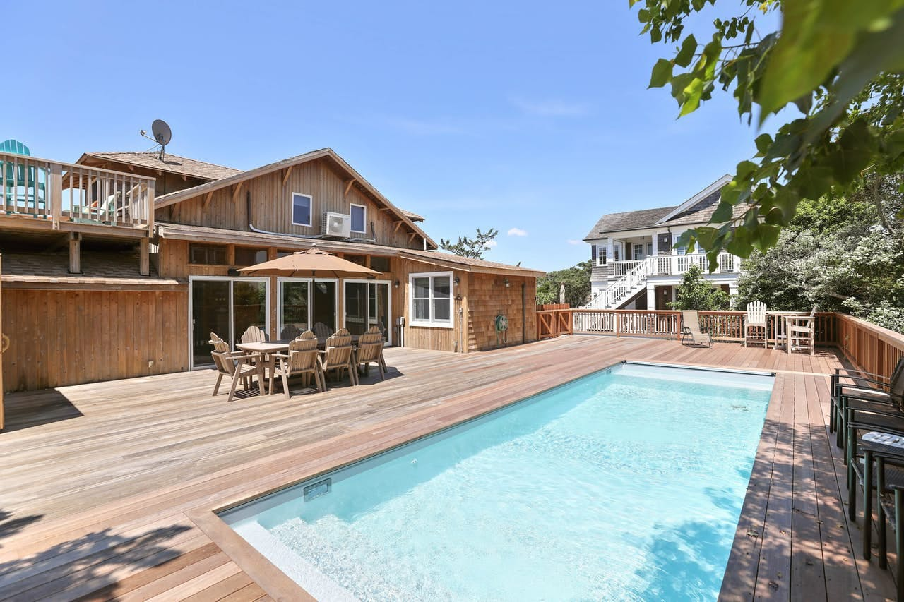 Backyard deck and pool of Fire Island, NY beach house rental