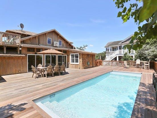 Backyard deck and pool of Fire Island, NY beach house rental