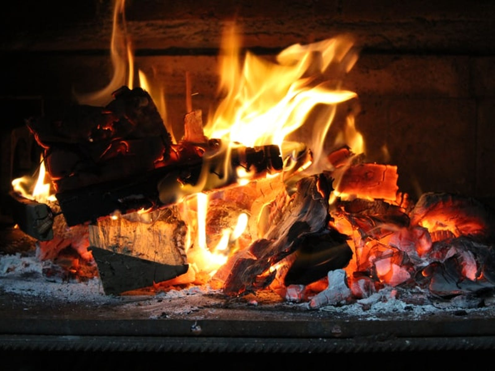 close up of fire in a log fireplace
