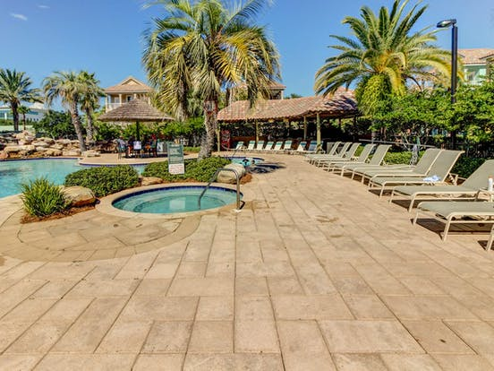 Shared outdoor pool and hot tub located in Destin, FL