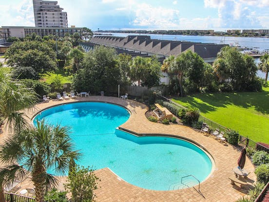 Fort Walton Beach, FL vacation condo rental with massive pool, ocean views, and beautiful landscaping