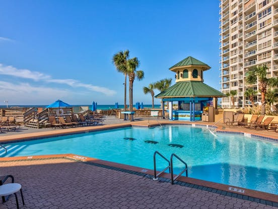 Resort community of Miramar Beach with outdoor pool and a poor bar
