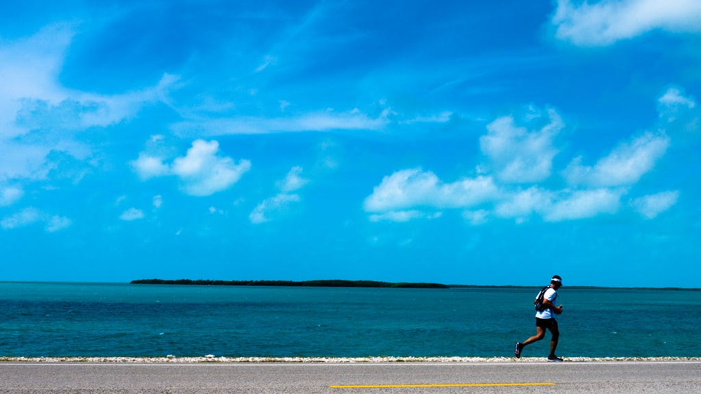 a man running along a beach n the florida keys