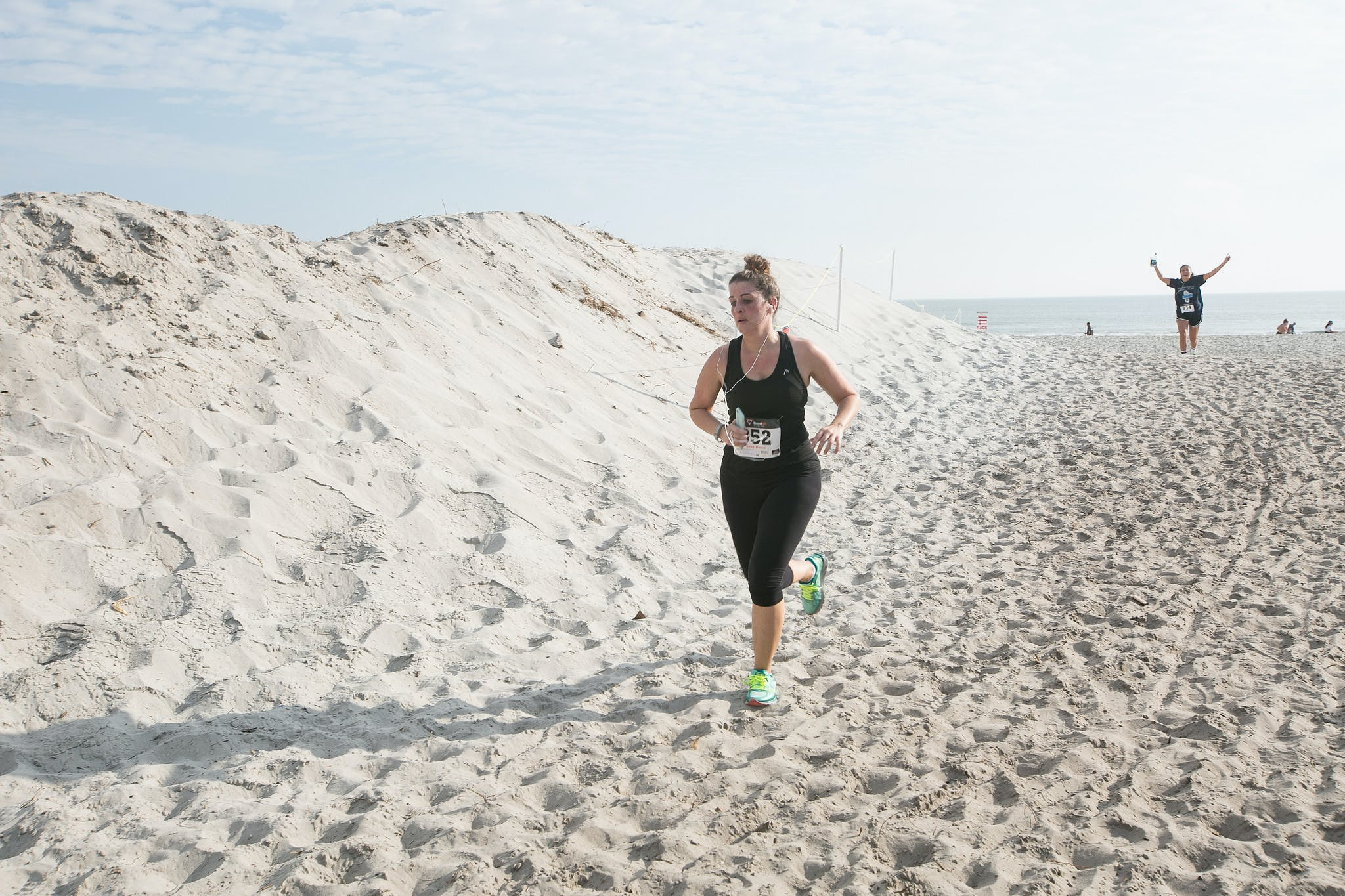 a woman running on the beach in a florida keys race