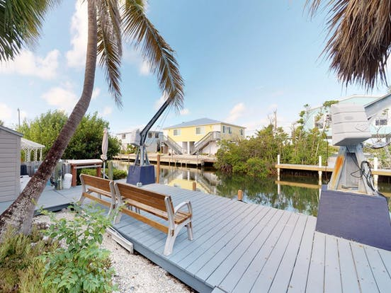 Vacation home located on a canal with a boat dock in Little Torch Key, Florida