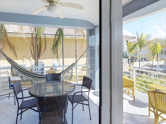 Vacation rental with patio area with hammock and canal views in Key Largo, FL