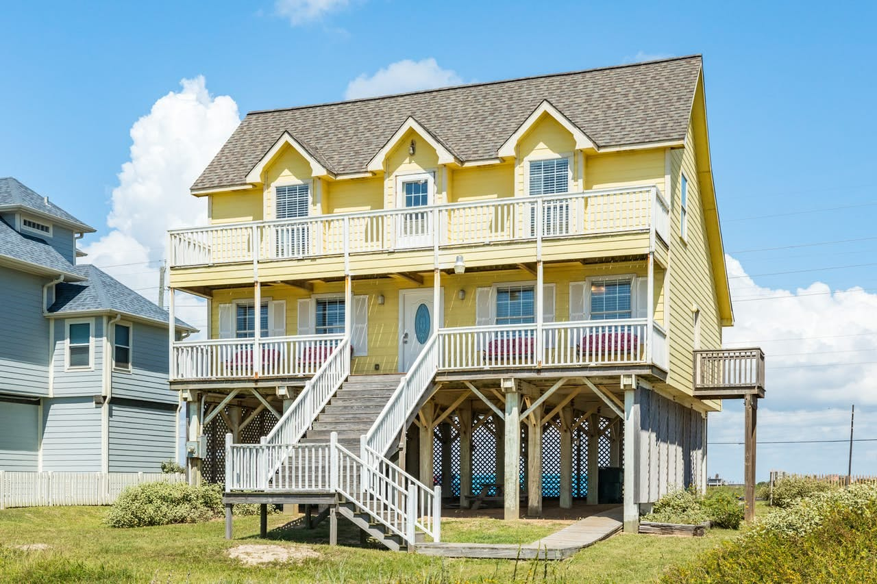 Yellow beach house located in Galveston, TX