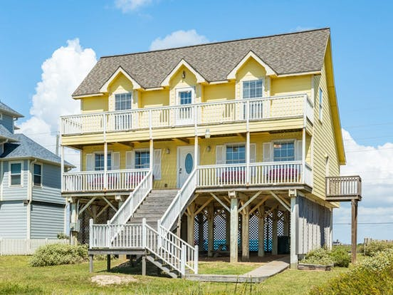 Yellow beach house rental in Galveston, TX
