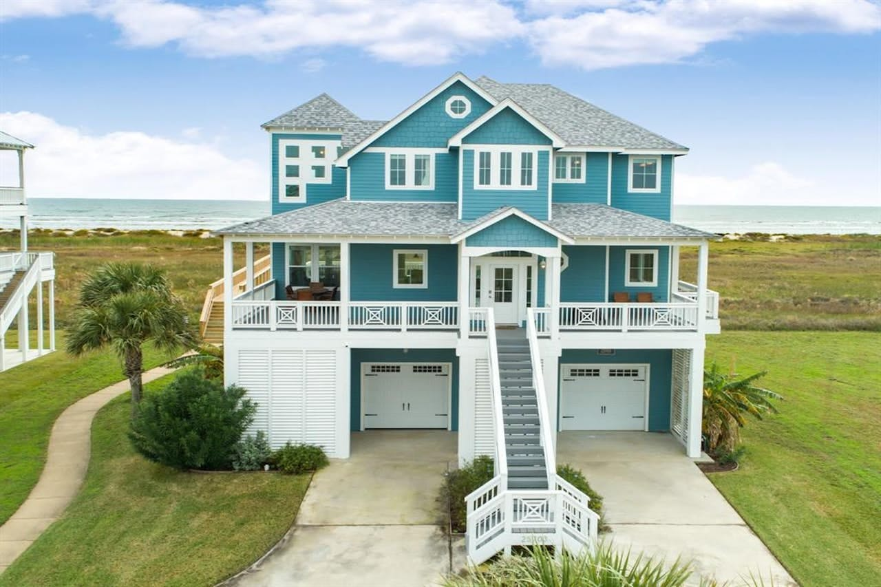 Teal beach house rental located in Galveston, TX