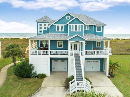 Teal beach house rental located in Galveston, TX