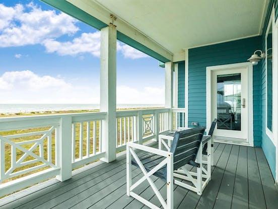 Deck of teal beach house rental in Galveston, TX