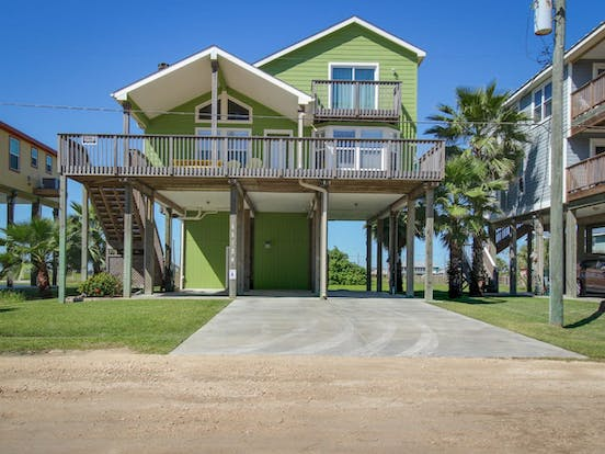 green beach house located in Galveston, TX