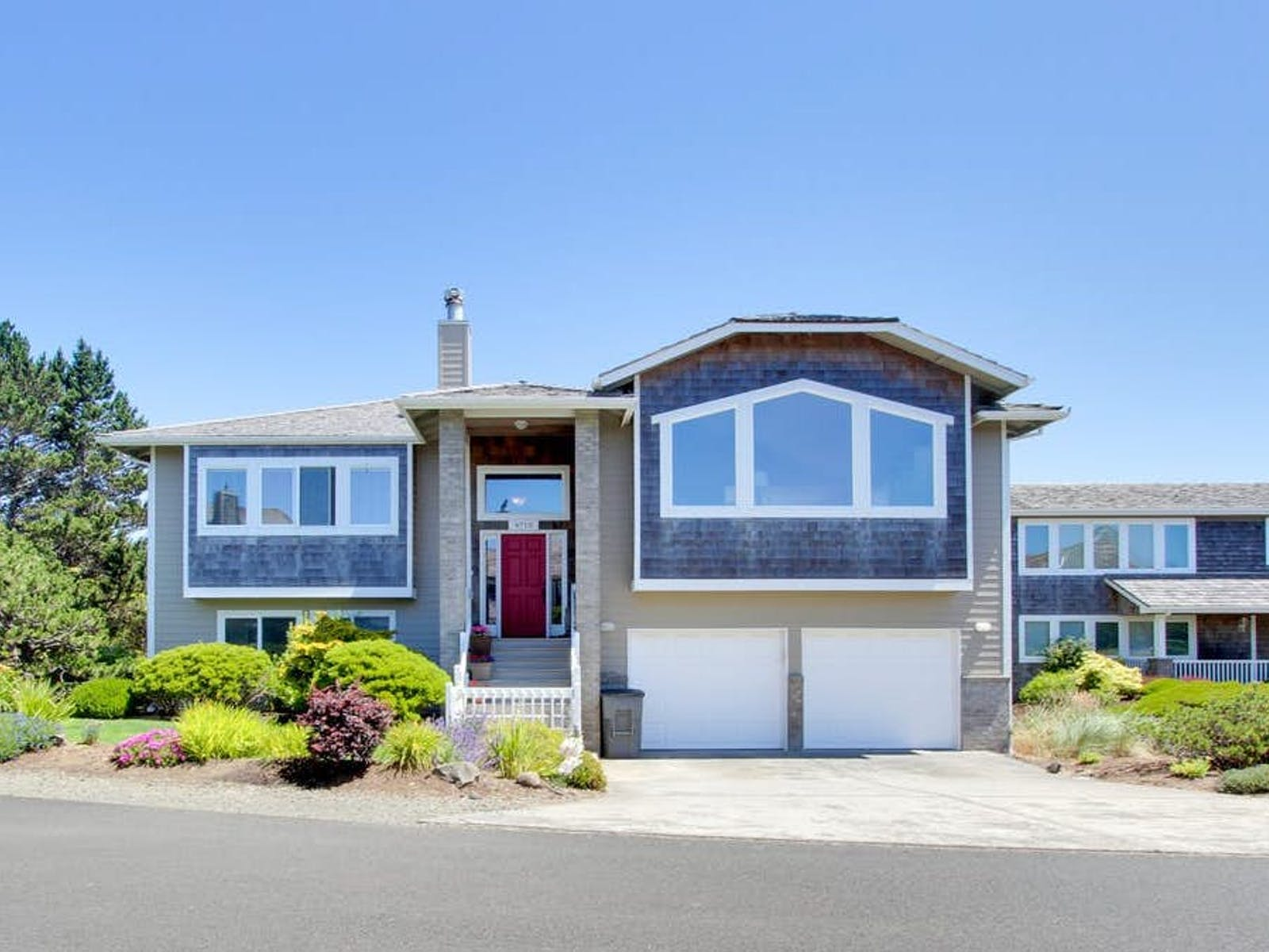Gearhart, OR vacation home with large windows and 2 car garage