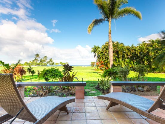 View of golf course from a vacation rental in Princeville, HI