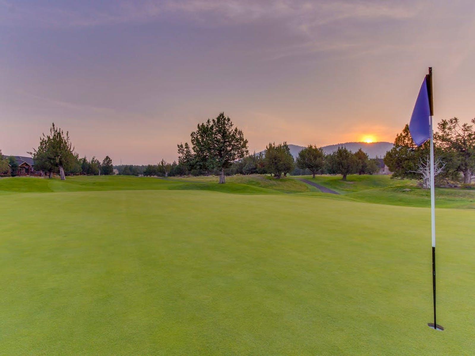 Sun setting over golf course