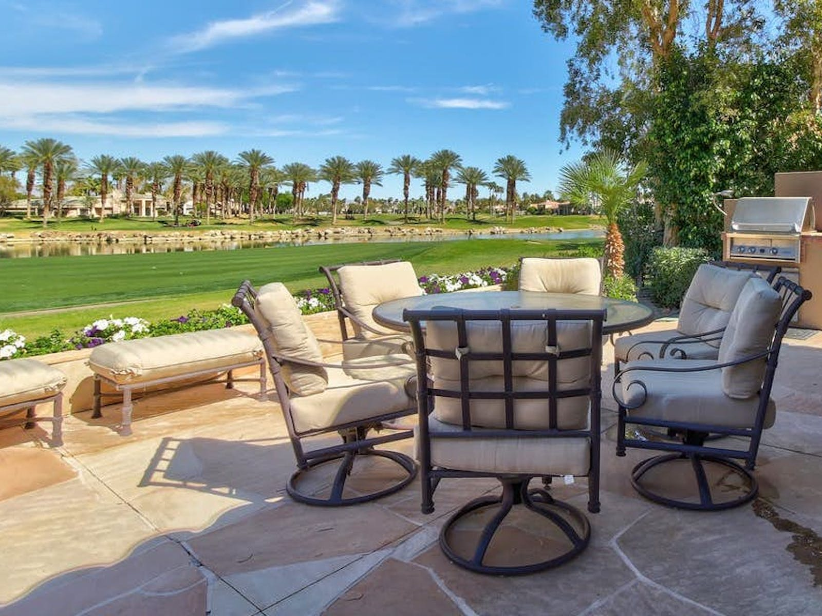 Patio of vacation rental located next to golf course