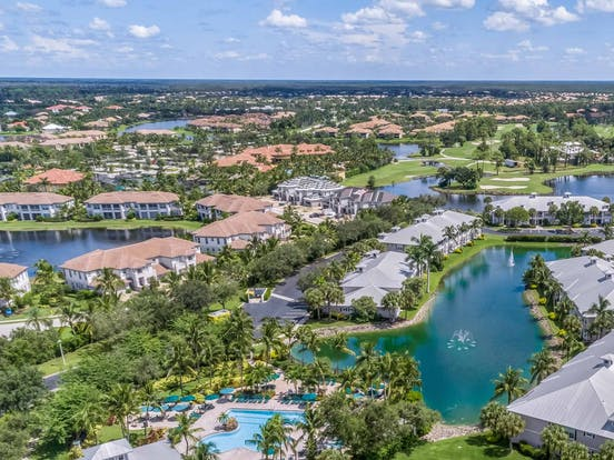 naples, fl aerial view with resort pools and golf course