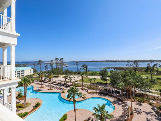 view of resort pool and golf course located in panama city beach, fl