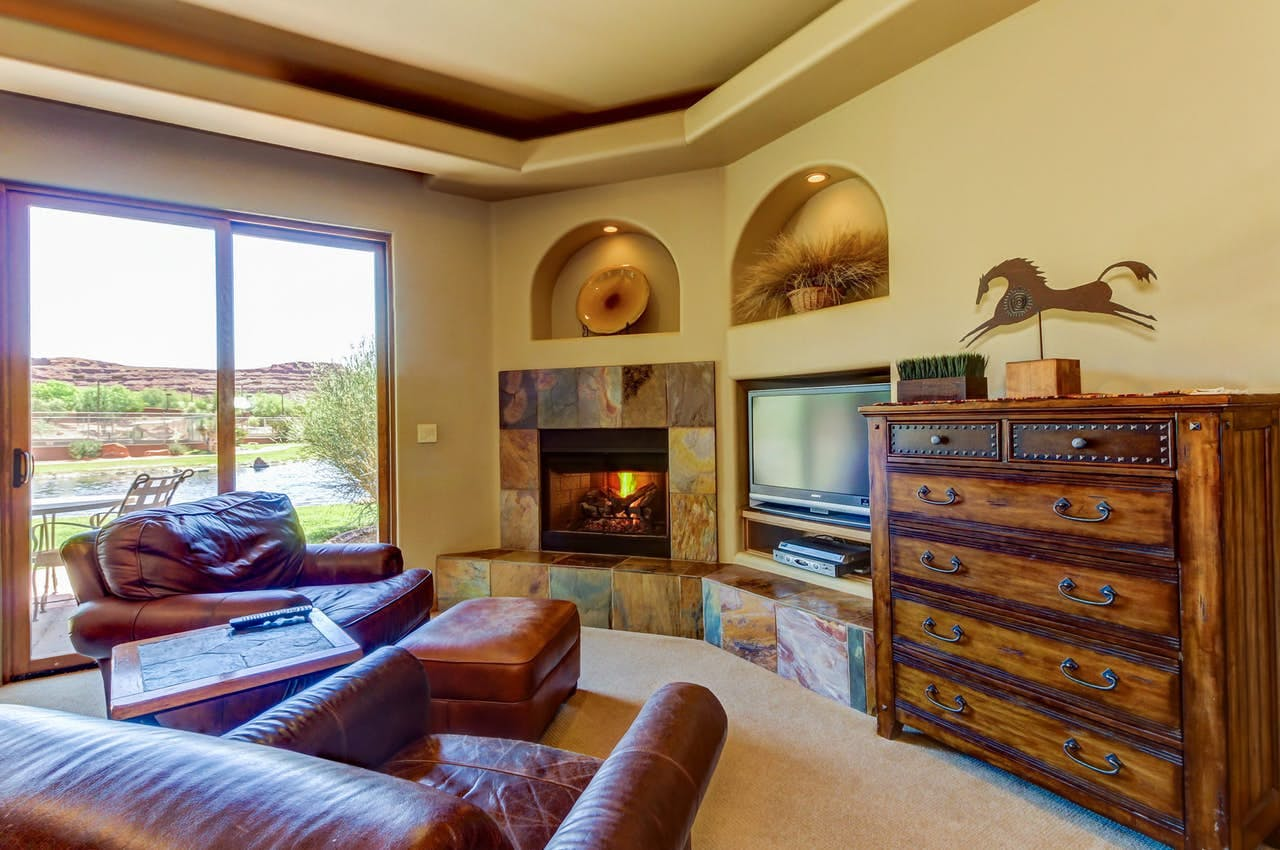 Living area with fireplace, comfy couches and beautiful views of St. George, UT