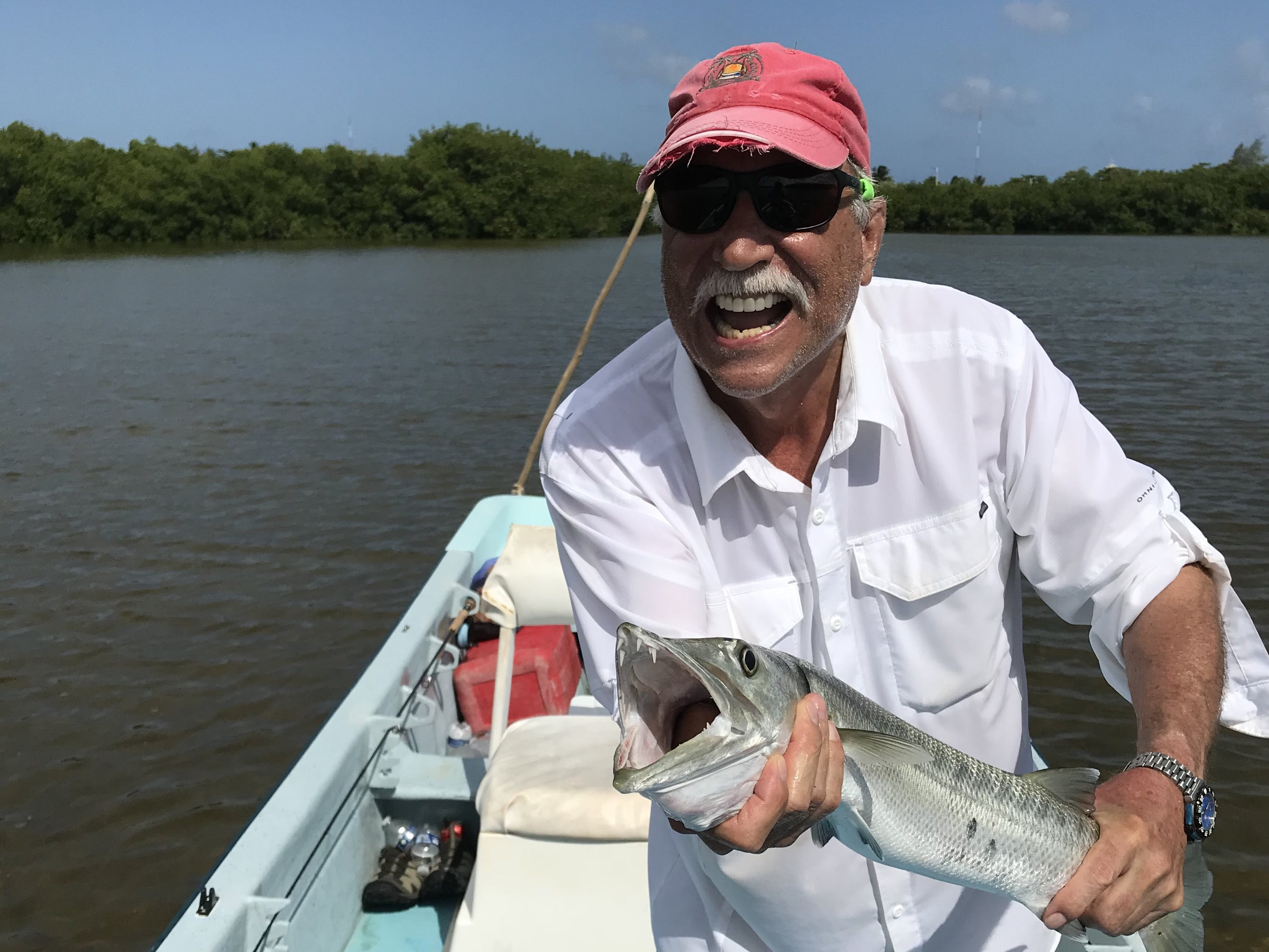 Gordon Paxman holding a fish after a successful day of fly fishing
