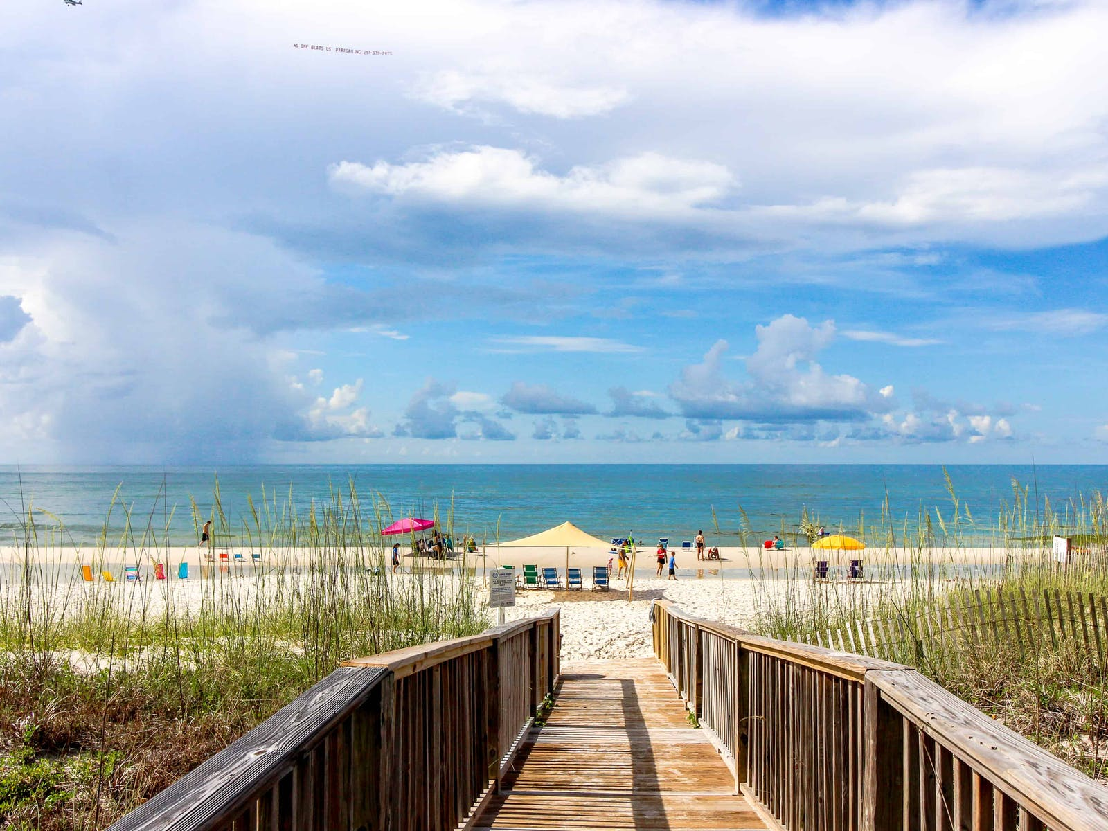 Gulf Shores, AL boardwalk leading from vacation rental to beach