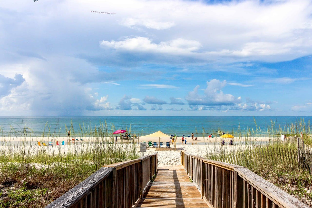 View of a Gulf Shores boardwalk leading to the beach and ocean