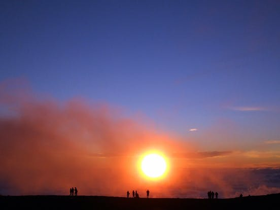 the sun rising at Haleakala