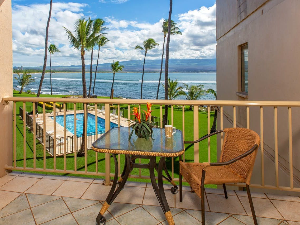 View of outdoor pool and ocean from vacation condo located in Wailuku, HI