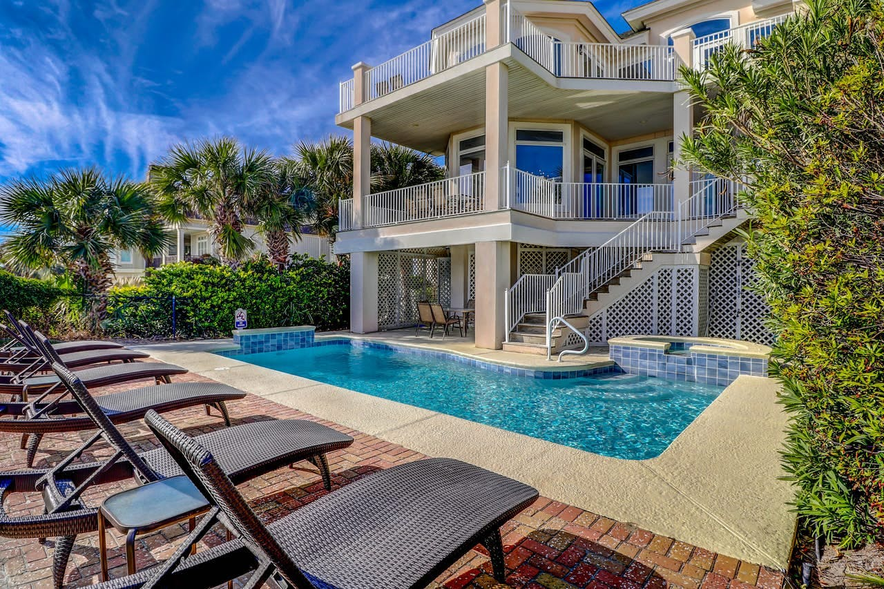 Beautiful pool on the back patio of three-story vacation home in Hilton Head
