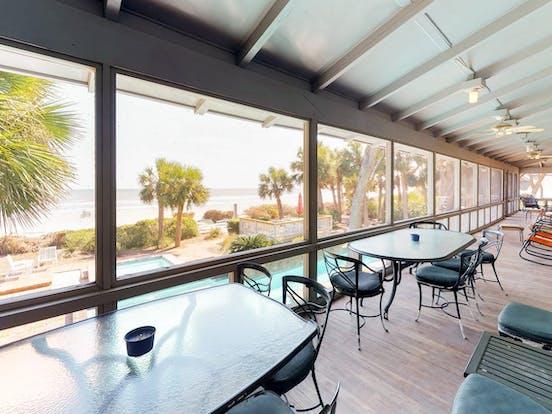 Enclosed patio with ocean views