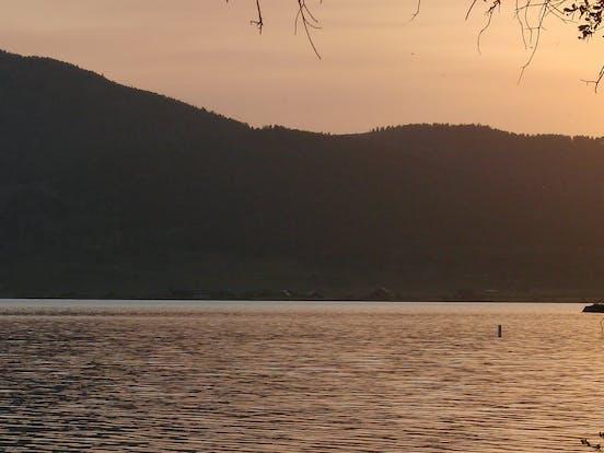 sun setting over a lake in idaho