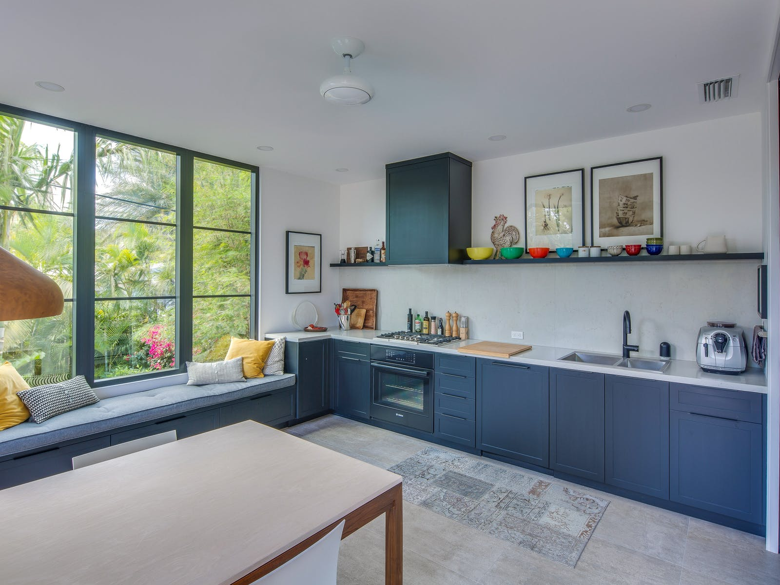Kitchen of Key West, FL vacation home with blue cabinets