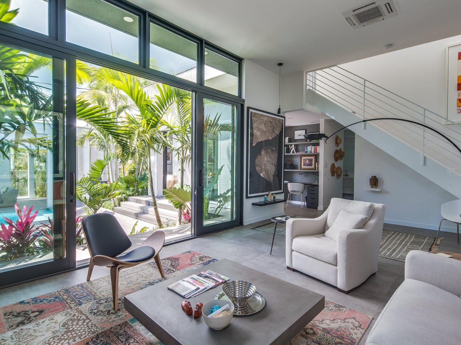 Living area of Key West, FL vacation rental with view of private pool