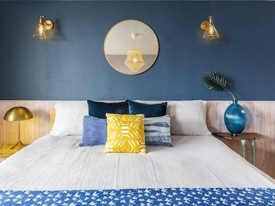 Blue-hued bedroom of vacation rental designed by Vacasa Home Interiors Program