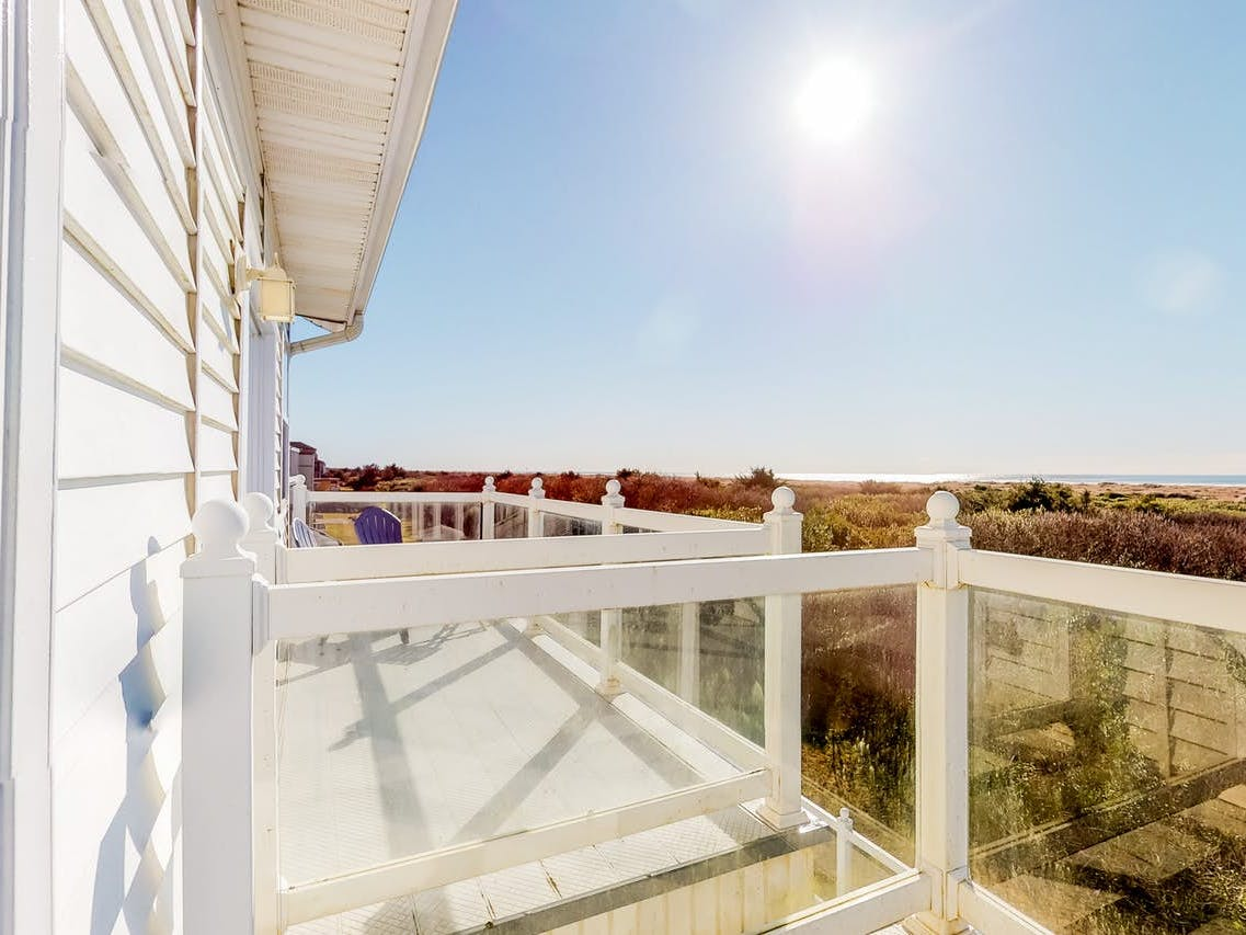 View of Ocean Shores beach from balcony of vacation rental at Judith Ann Inn