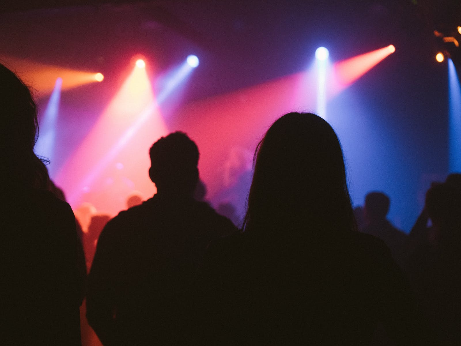 Silhouettes of festival-goers