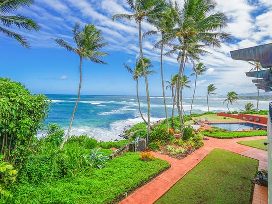 View of beach and ocean from oceanfront vacation rental in Kauai