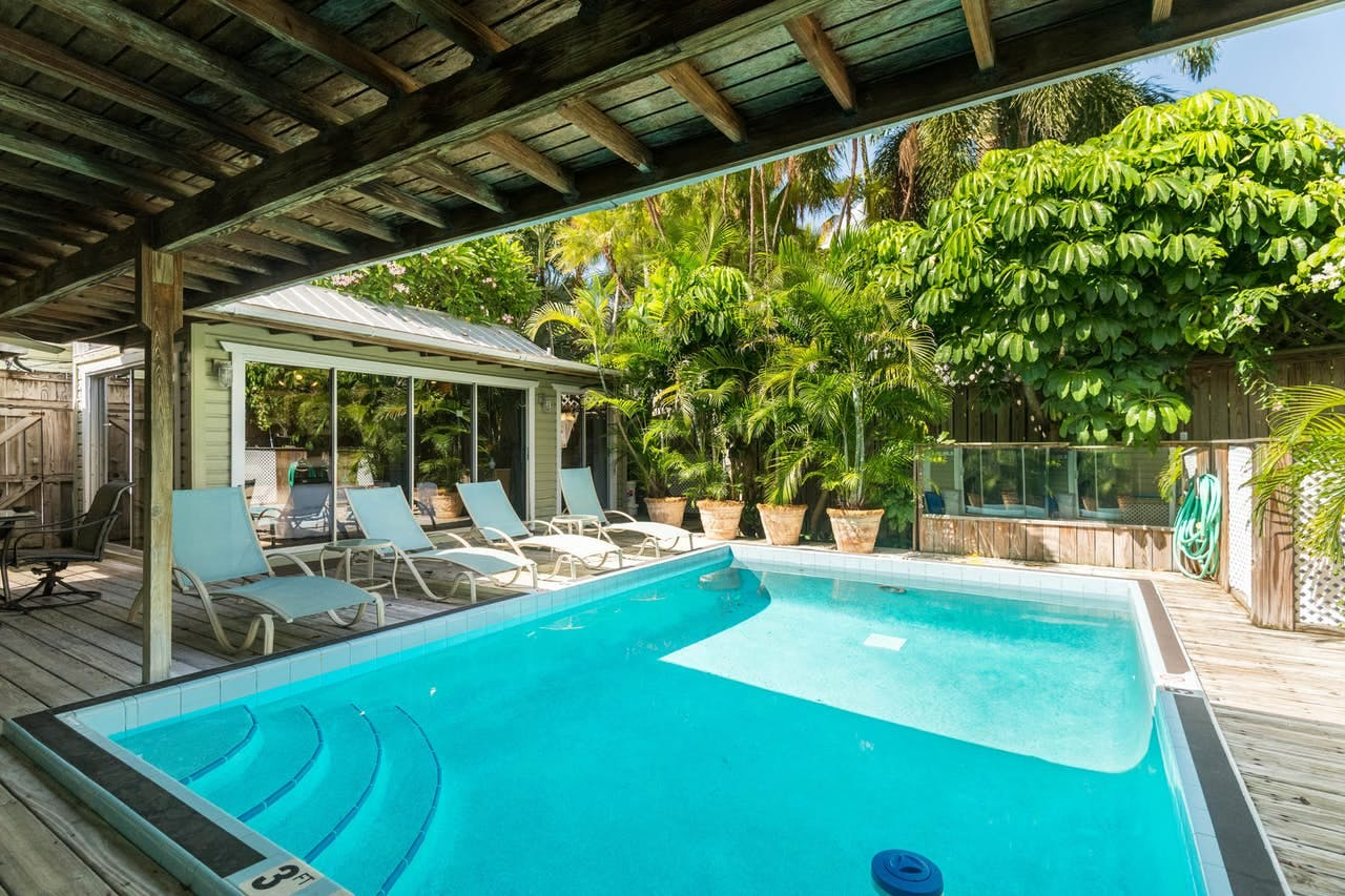 chairs by the pool at a key west vacation rental