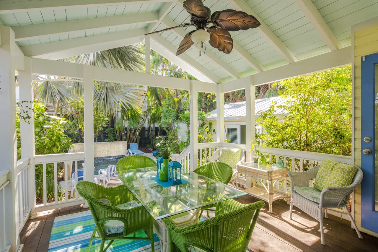 an outdoor dining area at a home in key west