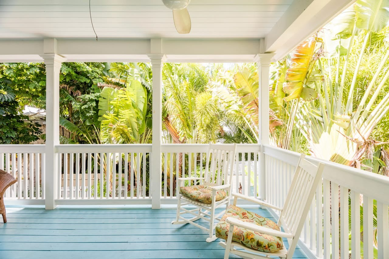 rocking chairs on the deck on a florida cottage