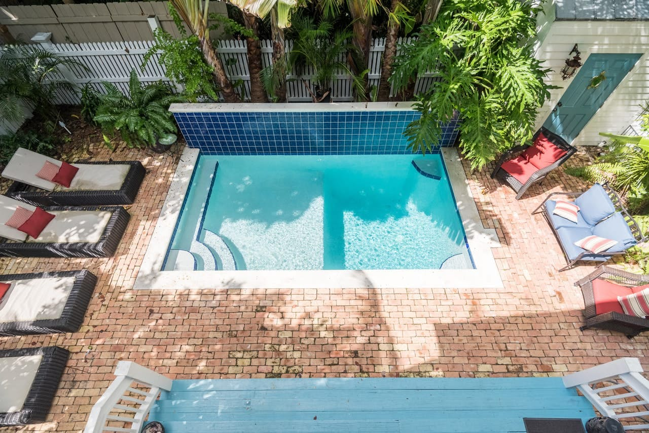 a private pool in the backyard of a key west cottage