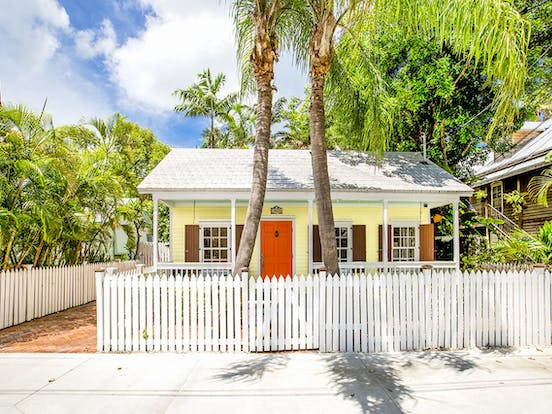 Yellow vacation cottage with orange door located in Key West, FL