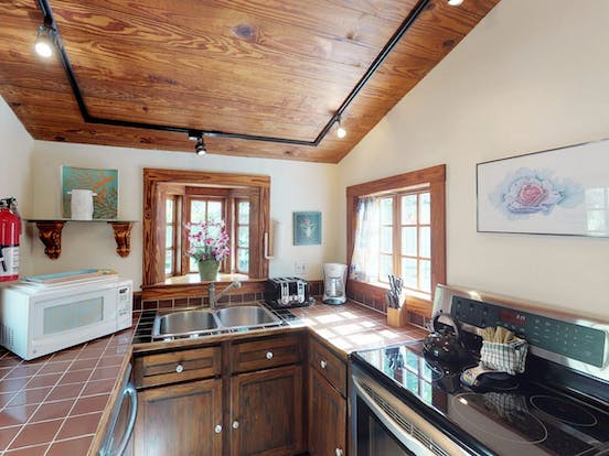 cozy kitchen with stove, oven and microwave of Key West cottage rental