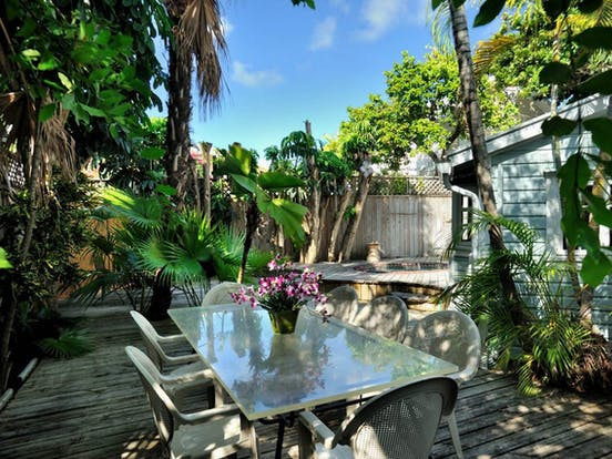 Large fenced backyard creates a private tropical sanctuary
