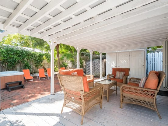 Hot tub and covered back patio of Key West, FL vacation cottage