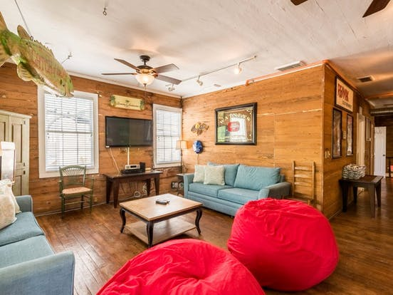Cherry red bean bags feature in this living room located in Key West