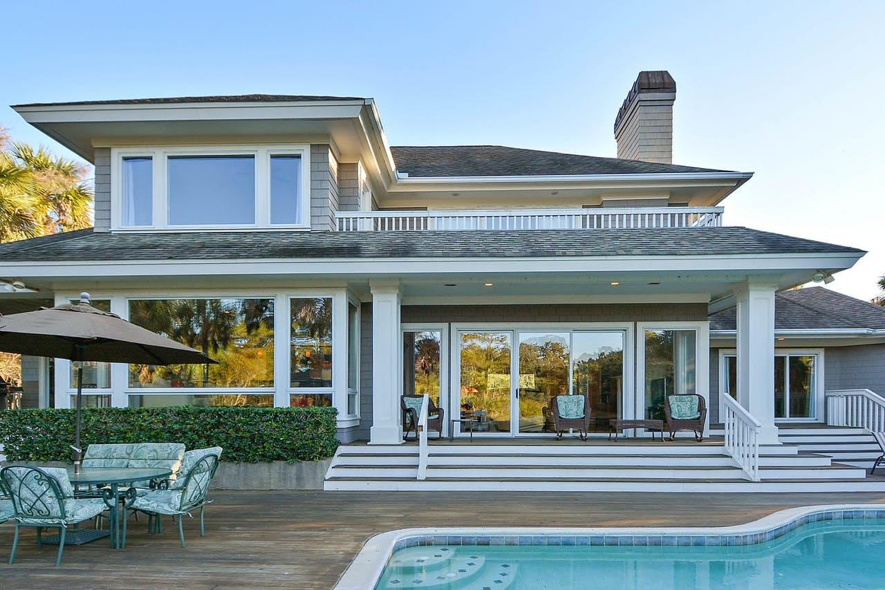 the backyard of a luxury vacation home with a pool on kiawah island