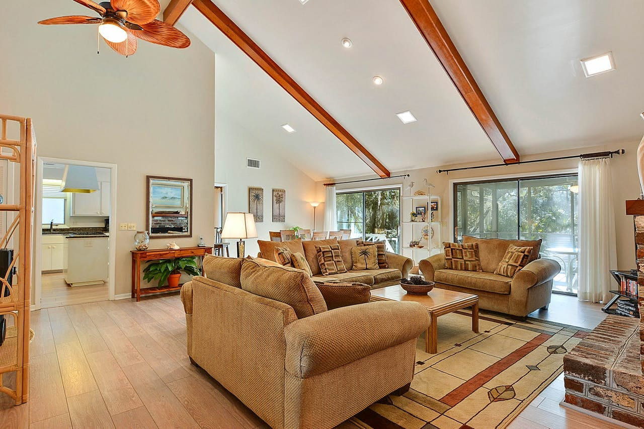 3 couches in a living room of a kiawah island vacation rental