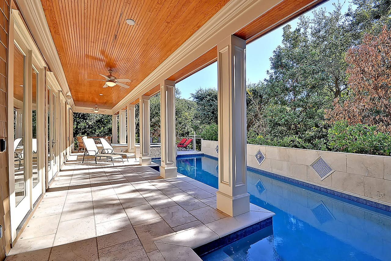a private pool outside of a luxury kiawah island home on a sunny day