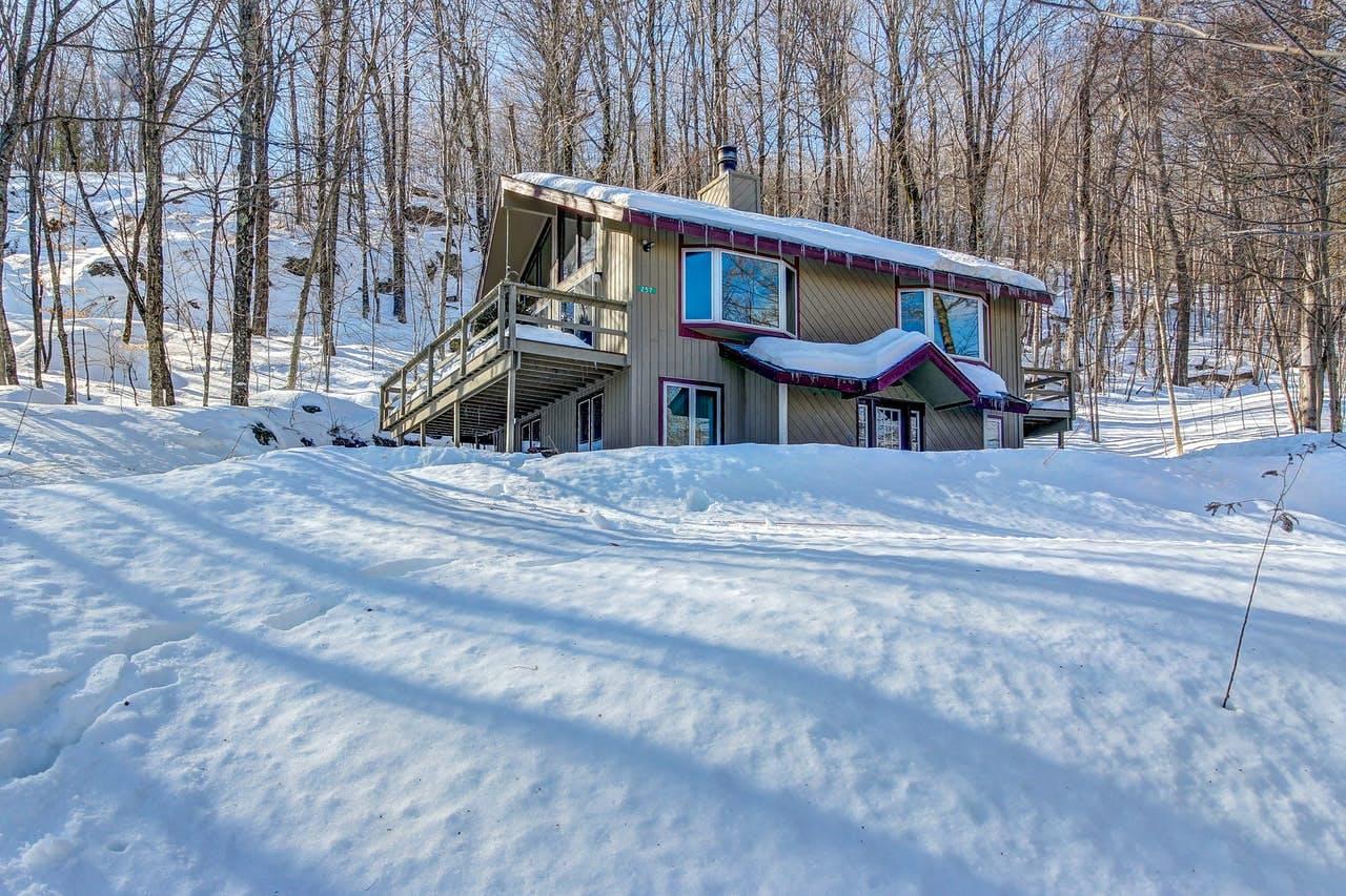 deep snow surrounding a Killington cabin on a sunny day